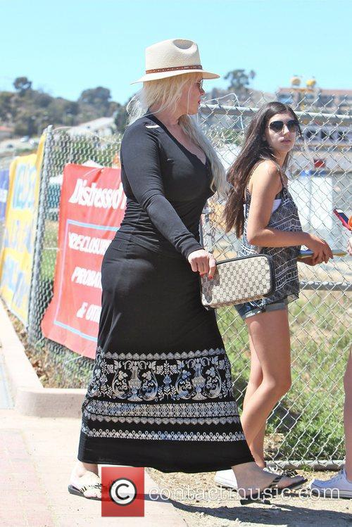 Former 'Cheers' actress dressed in a long black...