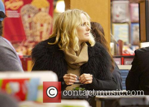Malin Akerman Malin Akerman pays for her groceries...