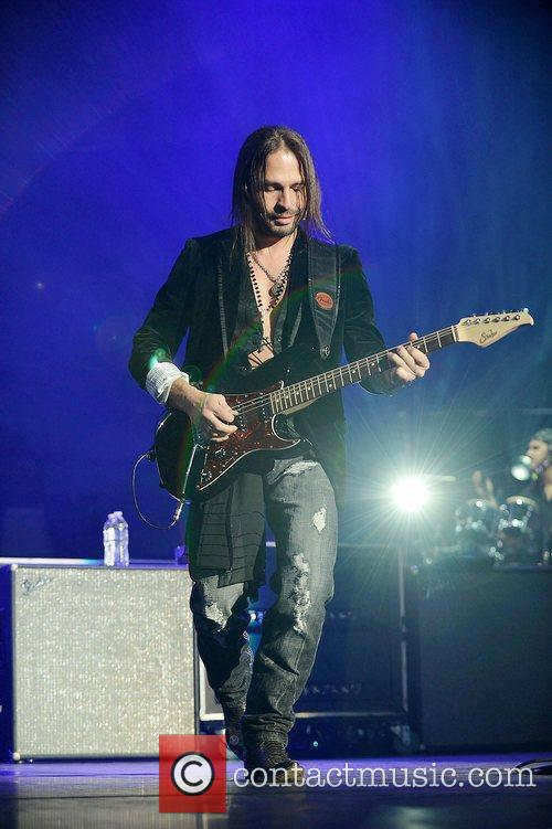 Sergio Vallan of Mana performs at AmericanAirlines Arena....