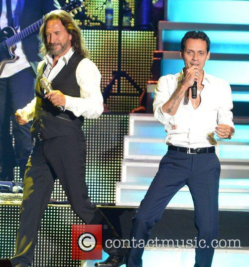 Marco Antonio Solis and Marc Anthony  performing...