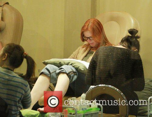 Marcia Cross having a manicure and pedicure at...