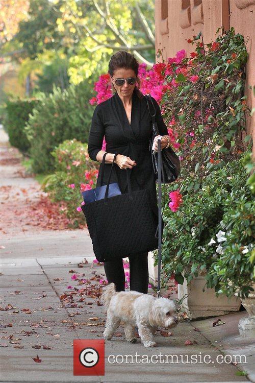 Maria Shriver walking her dog as she arrives...