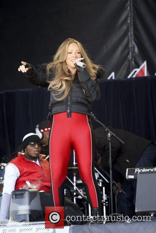 Mariah Carey performs in red and black skin...