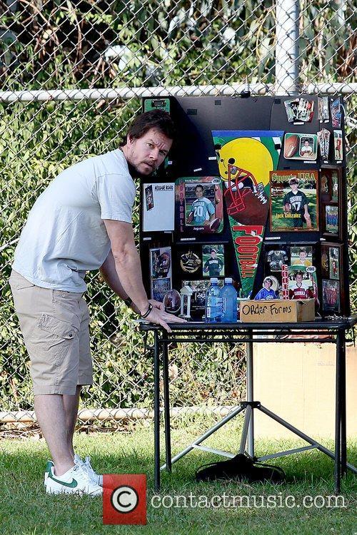 Mark Wahlberg ordering soccer photos Mark Wahlberg at...