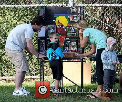 Mark Wahlberg with son Michael Wahlberg, ordering soccer...
