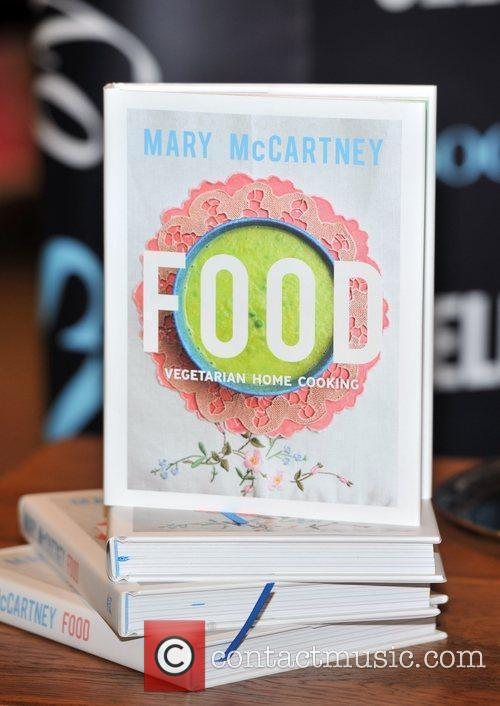 Signs her book 'Food: Vegetarian Home Cooking' at...