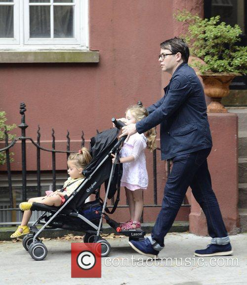 Walking his daughters Tabitha and Marion to school