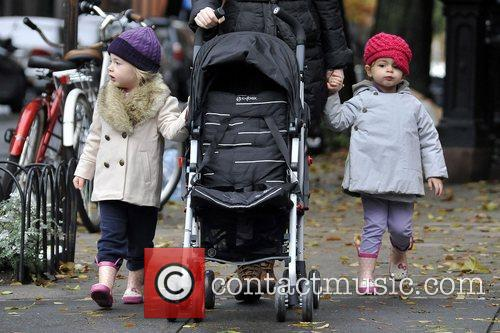 The twins walk with their nanny to school,...