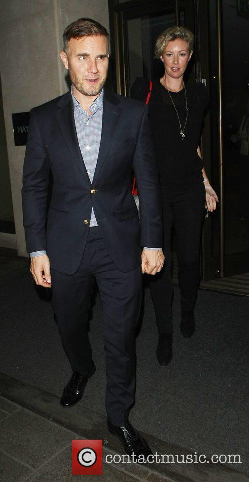 Gary Barlow and his wife Dawn leave the...