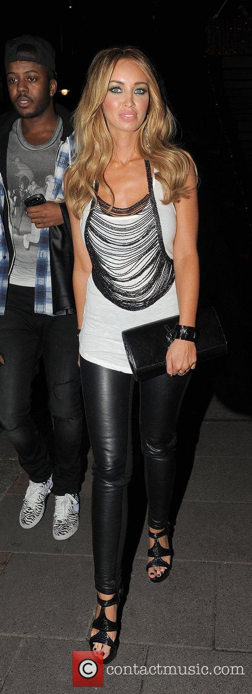 Lauren Pope and a male companion leaving the...