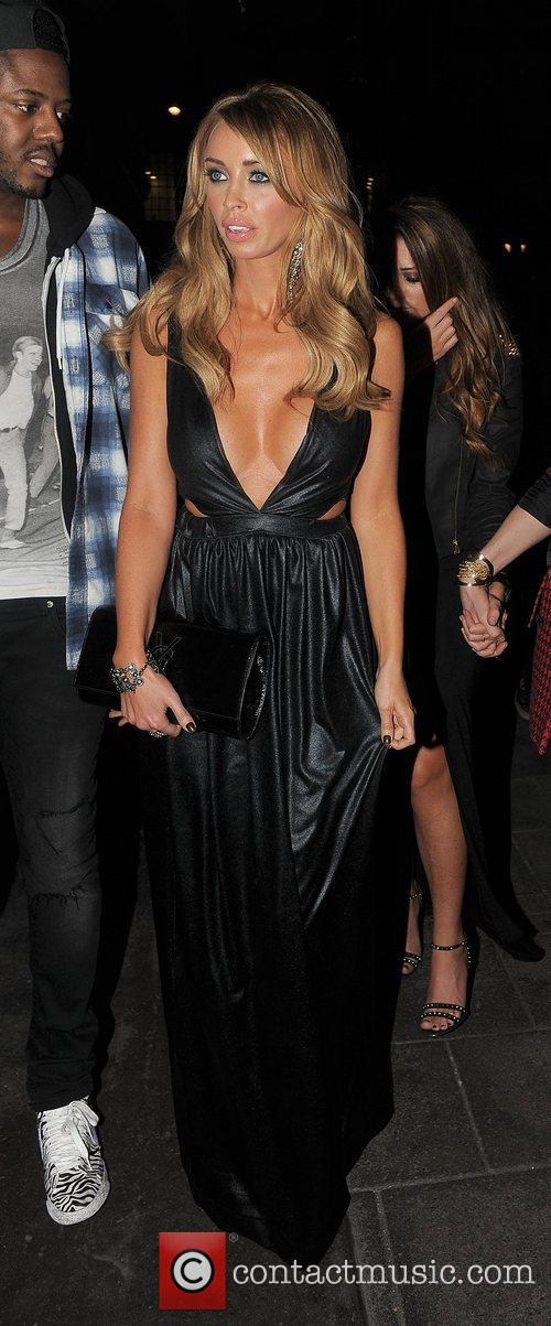 Lauren Pope and two male companions arriving at...