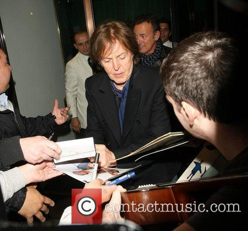 Bruce Springsteen and Paul McCartney leave Cecconi's Restaurant...