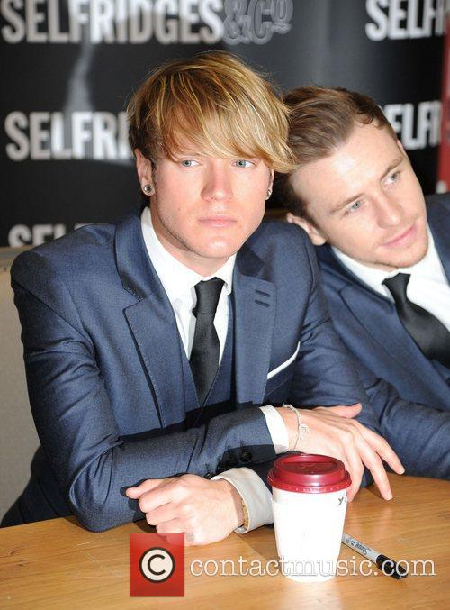 Dougie Poynter and Harry Judd McFly sign copies...