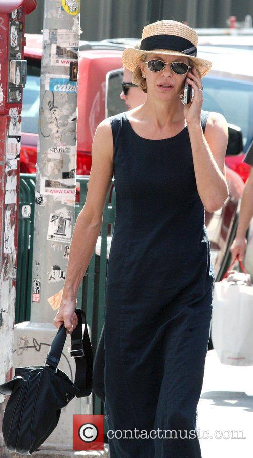 Meg Ryan out and about talking on her...