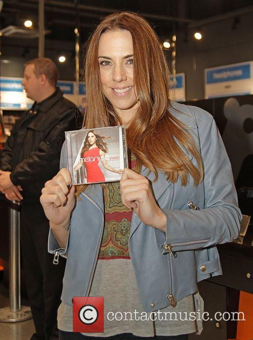 Melanie Chisholm aka Mel C signs copies of...