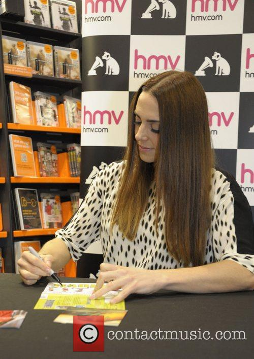 Signs copies of her album 'Stages' at HMV...