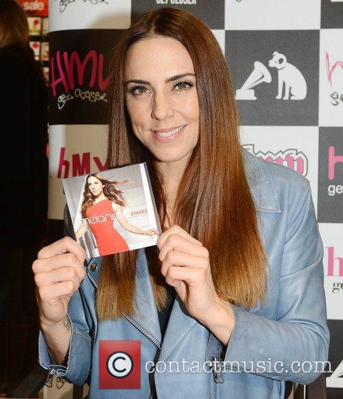 At a signing for her new album 'Stages'...