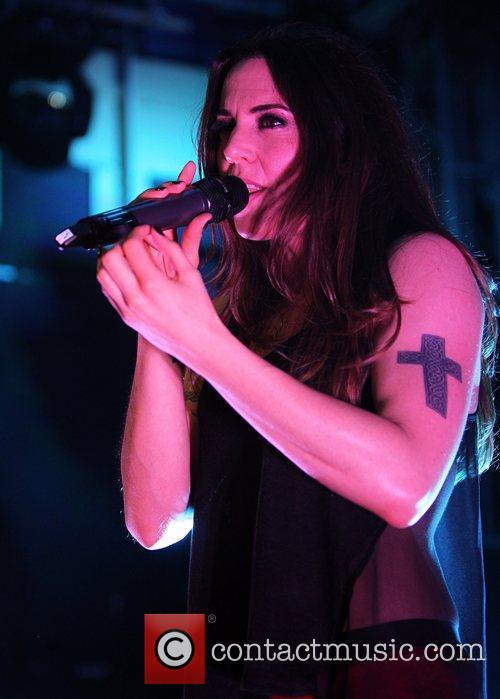 Melanie C (real name Melanie Chisholm) performing onstage...