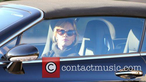 Melanie Griffith drives off after a day of...