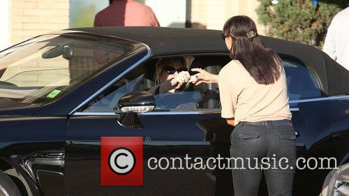 Melanie Griffith gives the parking attendant a $10...