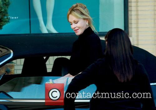 Melanie Griffith returns to her car after shopping...