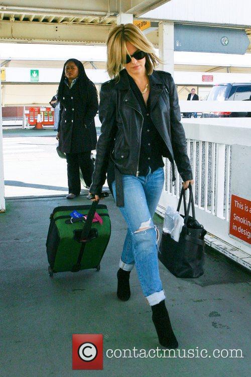 mena suvari arrives at heathrow airport to 5926462