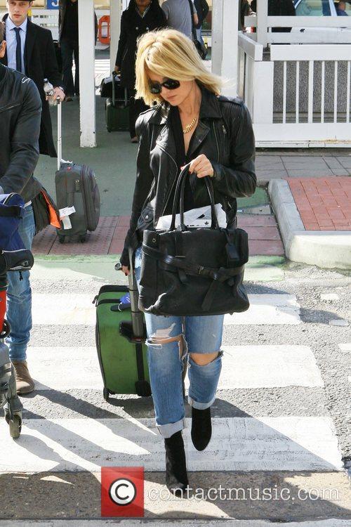 mena suvari arrives at heathrow airport to 5926464