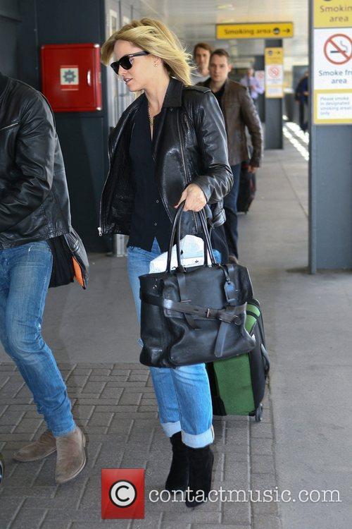mena suvari arrives at heathrow airport to 5926470