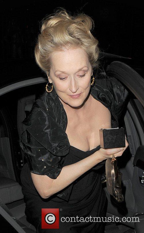 Meryl Streep arriving back at her hotel, holding...