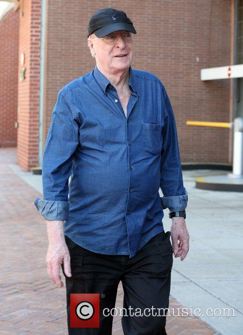 Michael Caine leaves a medical building in Beverly...