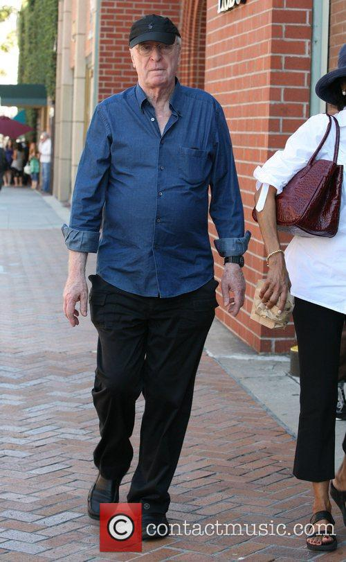 michael caine leaves a medical building in 3980882