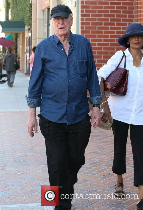 michael caine leaves a medical building in 3980885