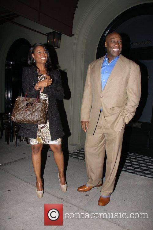 Michael Clarke Duncan and Omarosa Manigault-Stallworth  leaving...