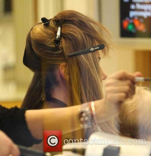 Michelle Heaton holds her daughter Faith as she...