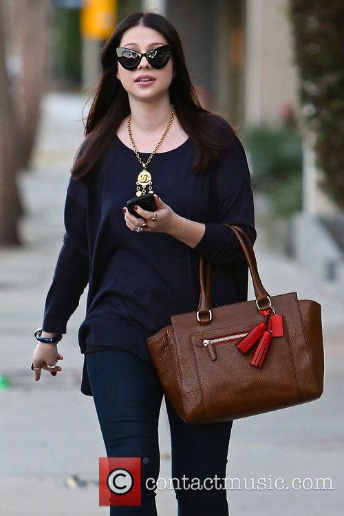 Seen leaving Salon Benjamin in West Hollywood carrying...