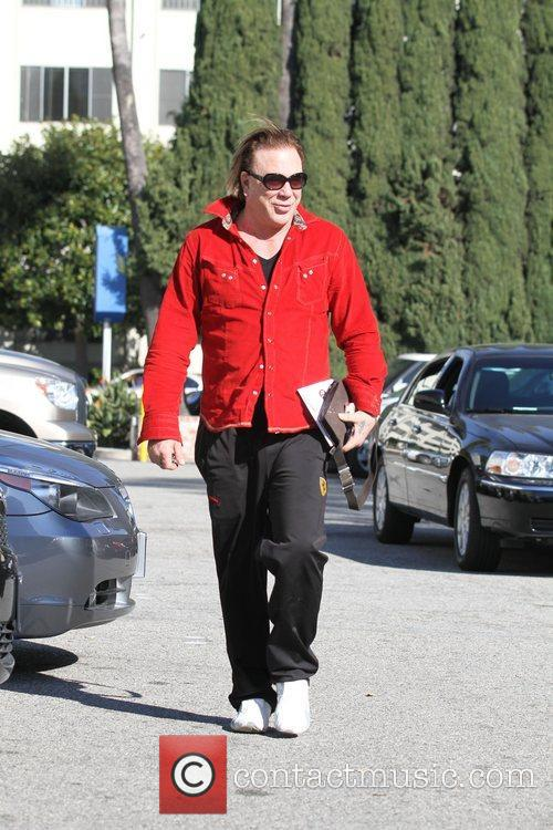 Mickey Rourke goes to meet friends for coffee...