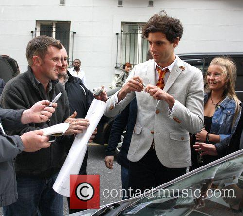 Mika signs autographs for fans ahead of his...