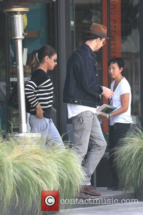 Mila Kunis and a male friend are seen...