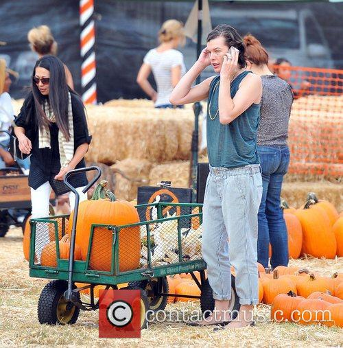 Milla Jovovich and Mr. Bones Pumpkin Patch 24