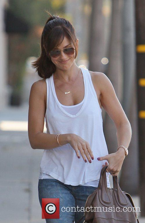 Minka Kelly returning to her car after leaving...