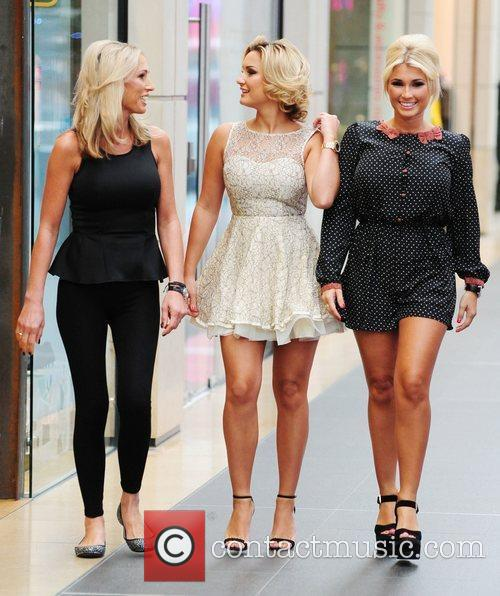 Sam Faiers and Billie Faiers attend the opening...