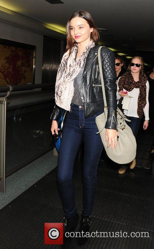Miranda Kerr arrives at Narita International airport in...