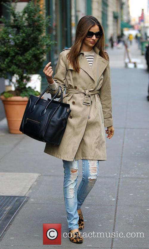 Miranda Kerr departs her apartment wearing a trench...