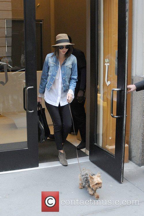 Miranda Kerr leaving her apartment to walk the...