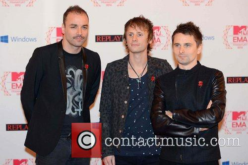 Christopher Wolstenholme, Dominic Howard, Matthew Bellamy and Muse 2