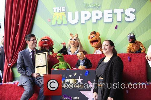Rich Ross, Lori MacPherson  The Muppets are...