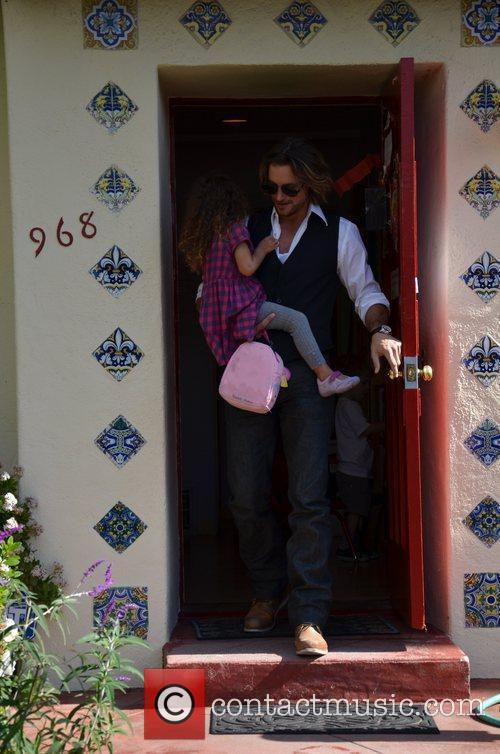 Gabriel Aubry picking up his daughter Nahla from...