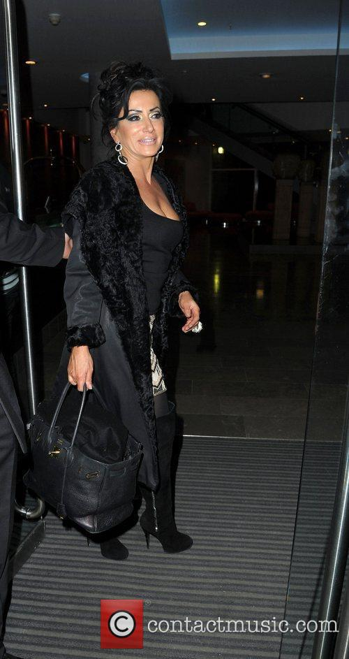 Nancy Dell'Olio,  return to their hotel after...