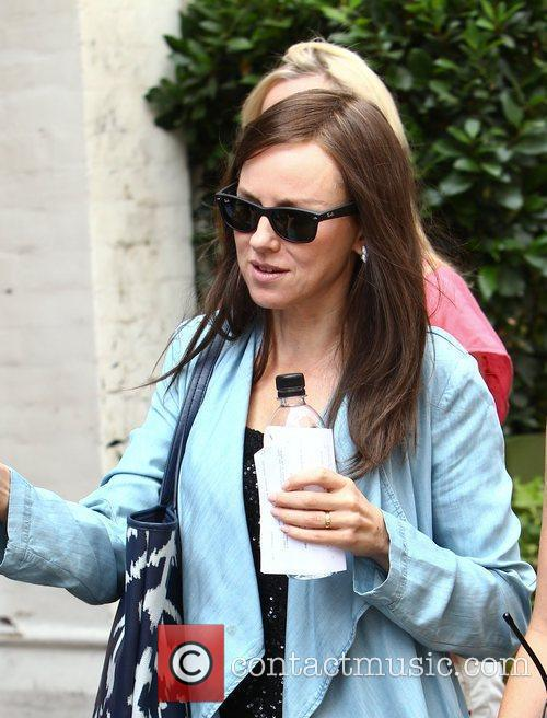 Naomi Watts dons a brown wig on the...