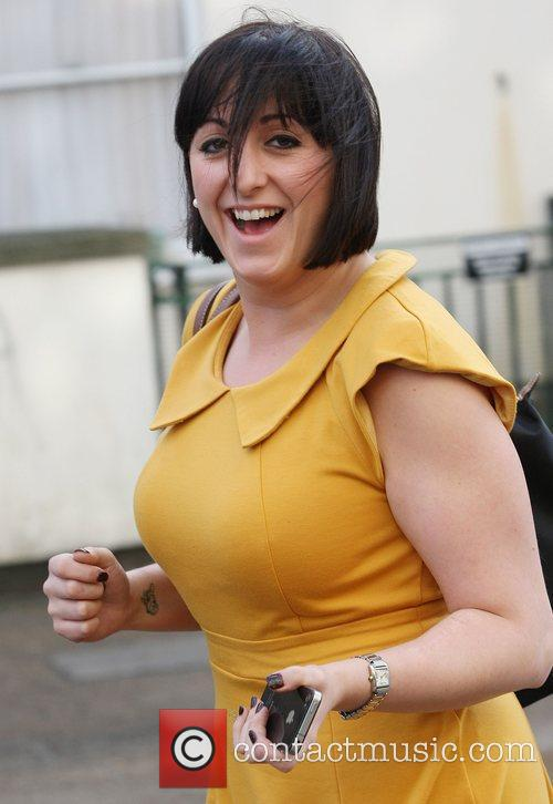 Wearing a mustard coloured dress as she leaves...